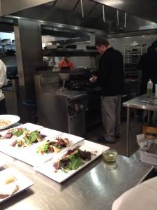 Inside Bistro Aida's kitchen watching the preparations